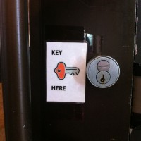 Thank goodness for this sign, so many doors lack them & it takes forever to figure out where to put the key...