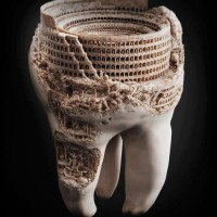 Roman Colosseum carved into human tooth. (Guess everybody needs a hobby...)
